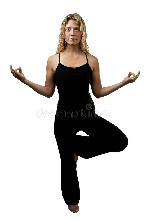 Yoga pose, blond woman standing on one foot royalty free stock photo
