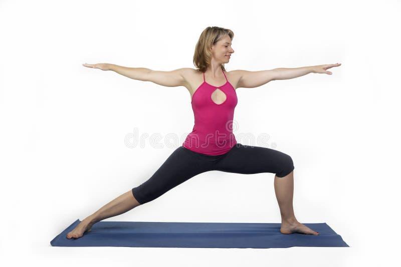 Yoga pose. S in studio - woman model exercising firs series of yoga stock image