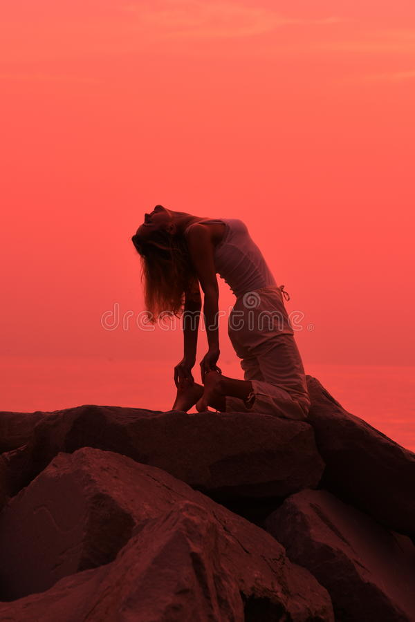 Download Yoga Pose At Sunset On The Beach Stock Image - Image: 30904015