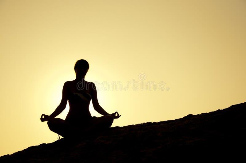 Yoga poses at sunrise royalty free stock photography