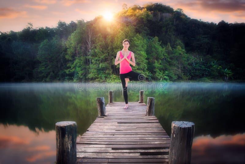 Yoga post on the wooded bridge stock photo