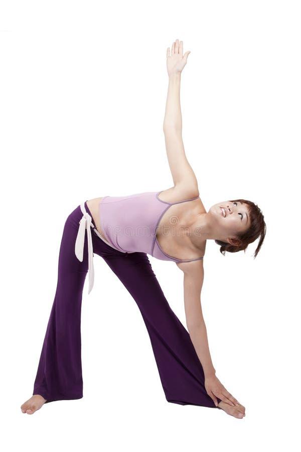Yoga practicante de la chica joven fotos de archivo