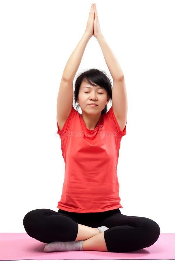Yoga practicante de la mujer aislada fotografía de archivo