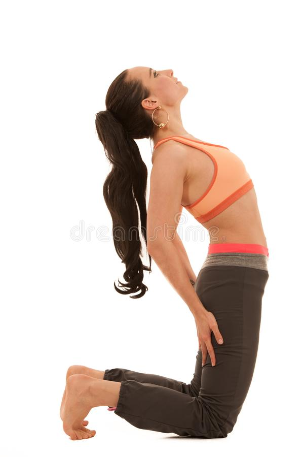 Yoga practice - beautiful young woman with black hair exercise y royalty free stock image