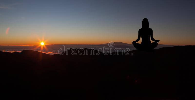 Yoga practicioner during the sunset meditation royalty free stock photo