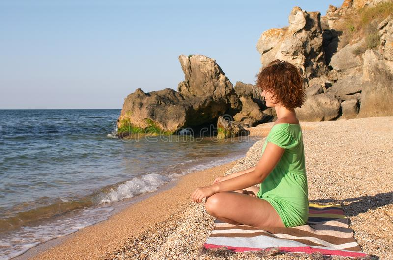 Yoga practise on the beach royalty free stock images
