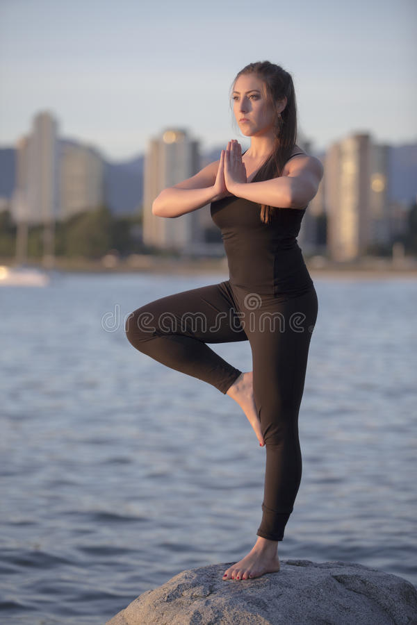 Yoga on a Rock at the Seaside royalty free stock images