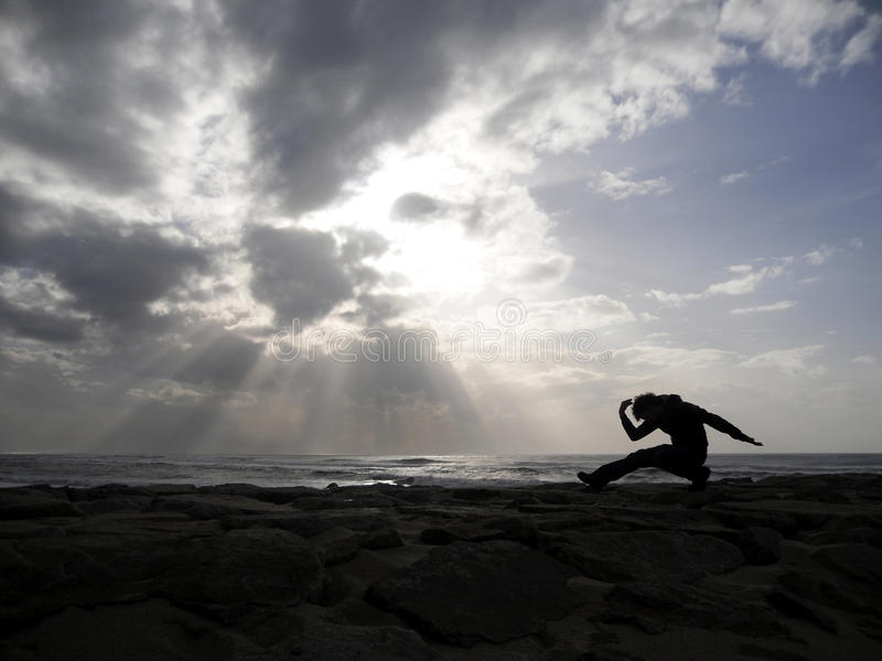 Yoga on the sea. Yoga exercise on the sea before a storm stock images