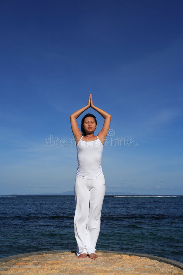 Yoga by Sea royalty free stock photography