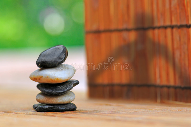 Download Yoga Shadow By Stacked Stones In Garden Stock Image - Image: 5956351