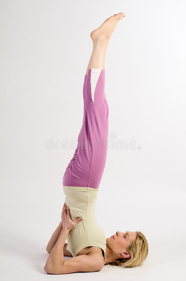 Yoga shoulder stand close stock images