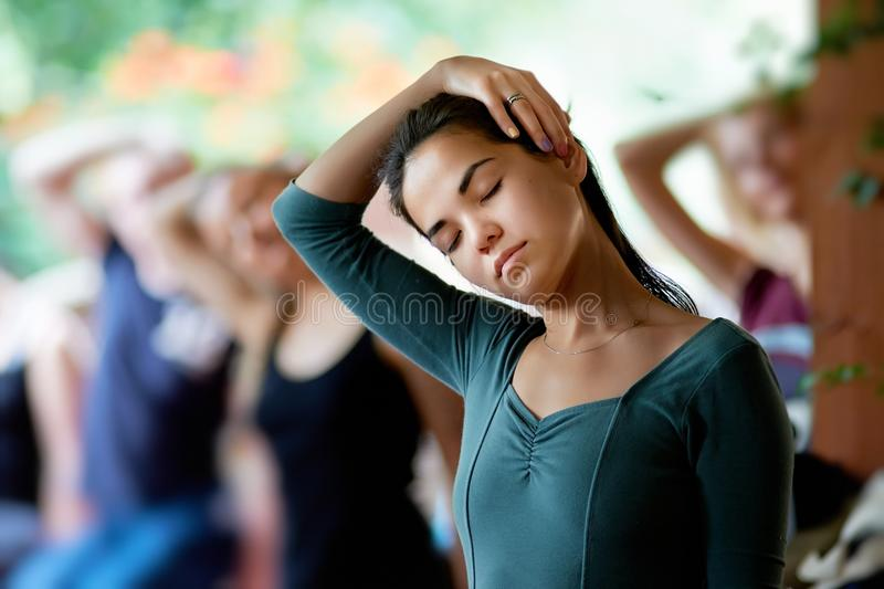 Yoga stretching neck royalty free stock image