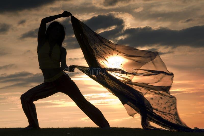 Yoga sun dance 3 stock photo
