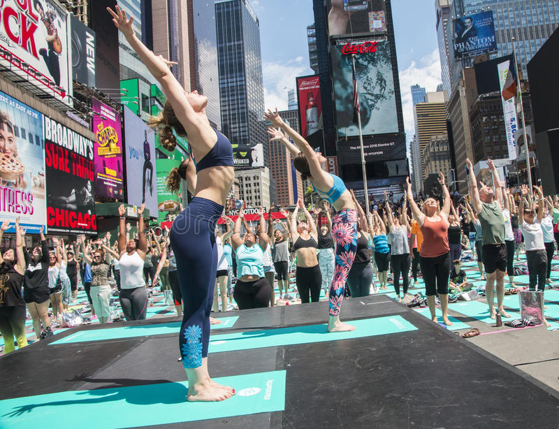 Yoga At Times Square. Is an annual event that takes place at the beginning of summer. Thousands of people came to NY to participate in yoga classes. This year`s royalty free stock image