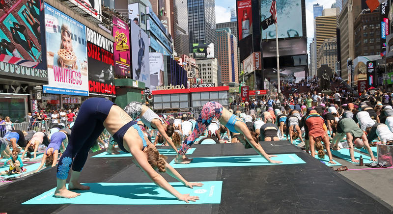 Yoga At Times Square. Is an annual event that takes place at the beginning of summer. Thousands of people came to NY to participate in yoga classes. This year`s stock images