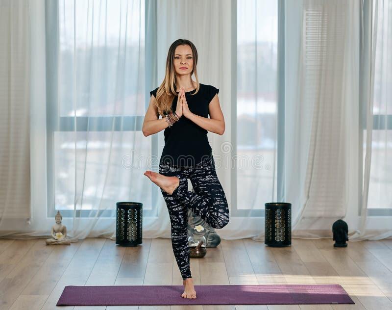 Yoga trainer executing asana. Yoga trainer in various postures asana in a studio stock photos