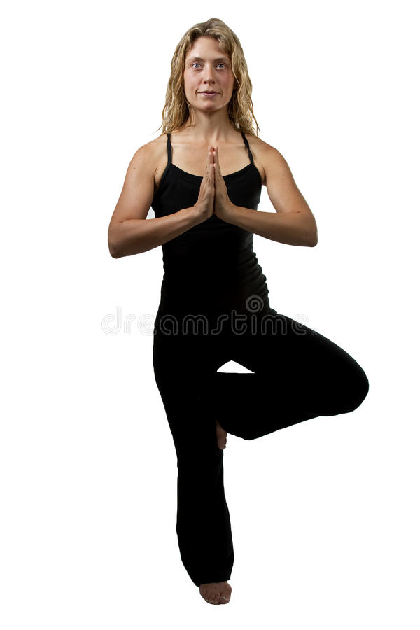 Yoga tree pose, blond woman standing on one foot stock photos