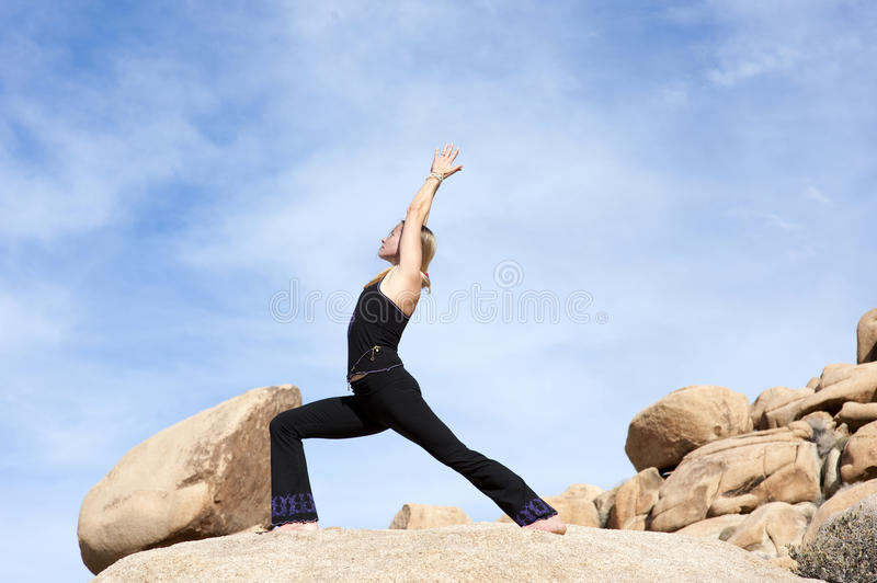 Yoga Virabhadrasana 1 images stock