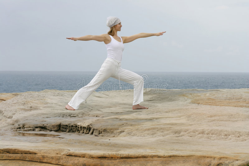 Yoga - Virabhadrasana II royalty free stock photography
