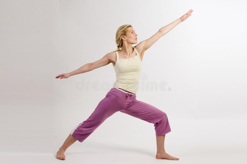 Yoga warrior pose royalty free stock photos