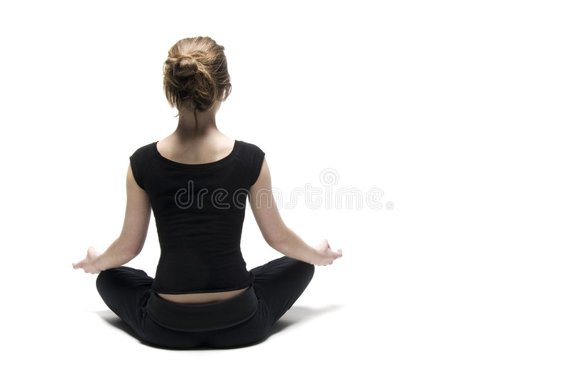 Yoga woman. Woman seated in lotus position on white background stock photography
