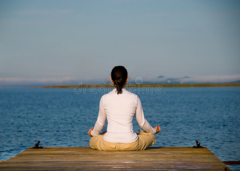 Yoga Woman. On a dock by the ocean royalty free stock photos