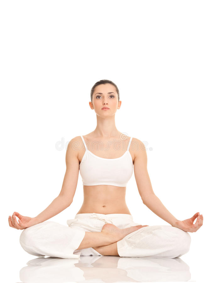 Yoga, woman in lotus position. Young woman practicing yoga in the lotus position, isolated on white royalty free stock photo