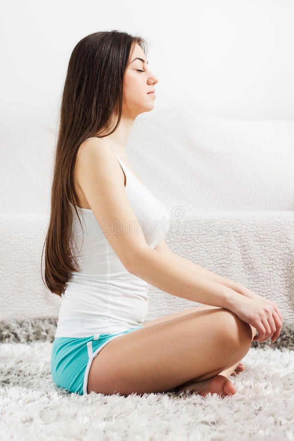 Yoga Woman Meditating Relaxing Healthy Lifestyle. Yoga Meditation Woman Relaxing at home.Healthy Lifestyle in Lotus Posture .Caucasian female meditate on the royalty free stock photos