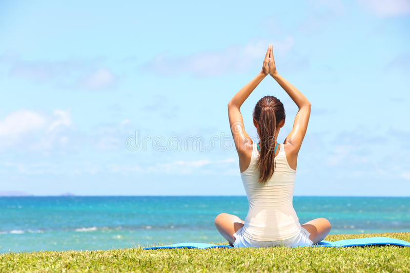 Download Yoga woman relaxing by sea stock photo. Image of meditation - 31969772