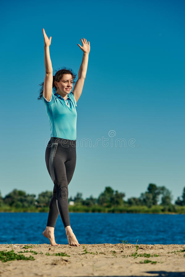 Yoga woman on the riverside royalty free stock images