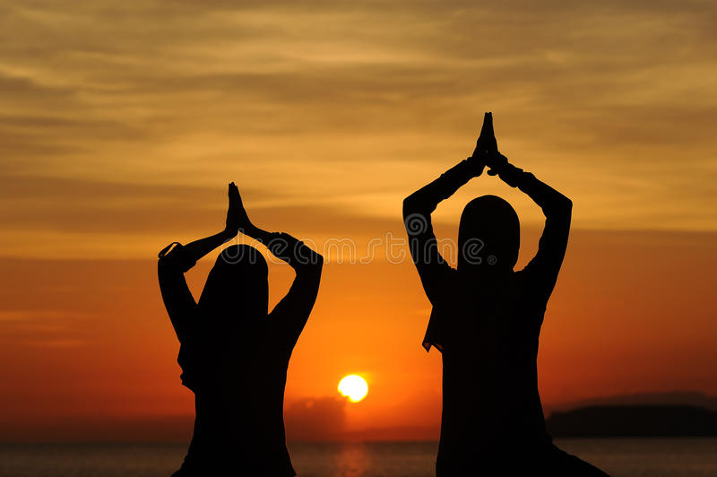 Yoga woman in sunset view royalty free stock image