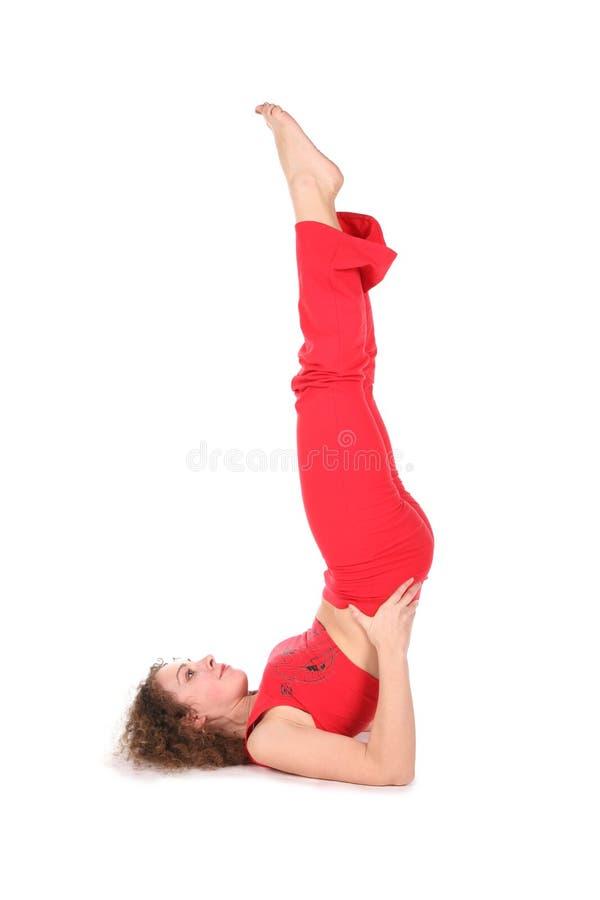 Yoga woman training, legs up. On white stock photos