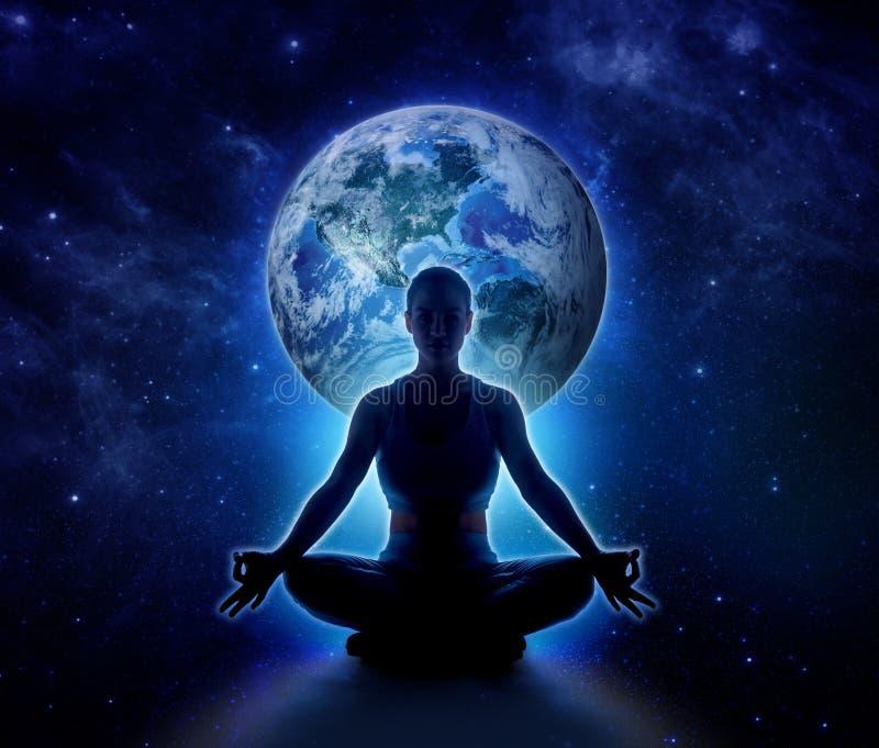Yoga woman on the world. Meditation girl on planet earth stock photo