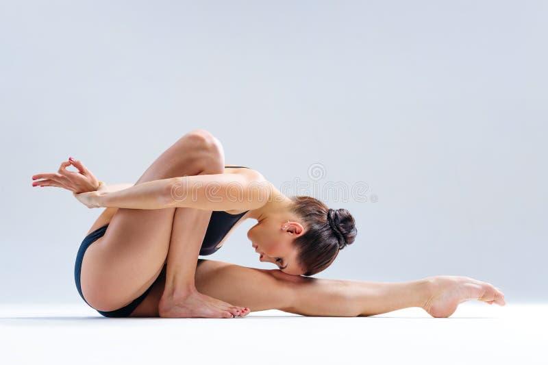 Yoga woman. Young beautiful yoga female posing on a studio background