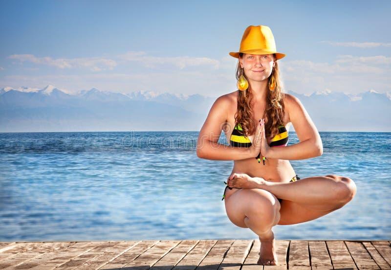 Download Yoga in yellow hat stock image. Image of asana, ardha - 26621301