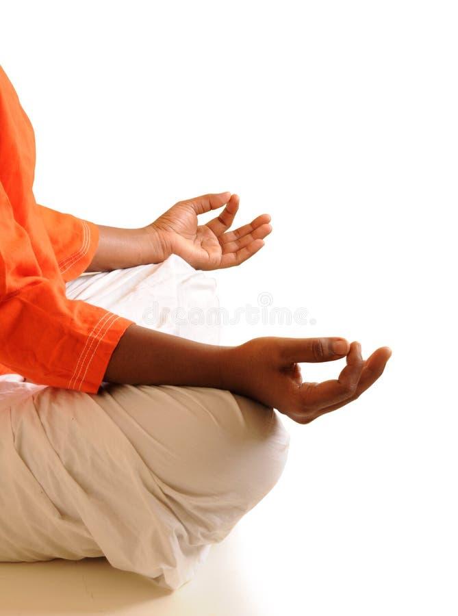 Yoga. Young teen girl doing yoga on white background stock image