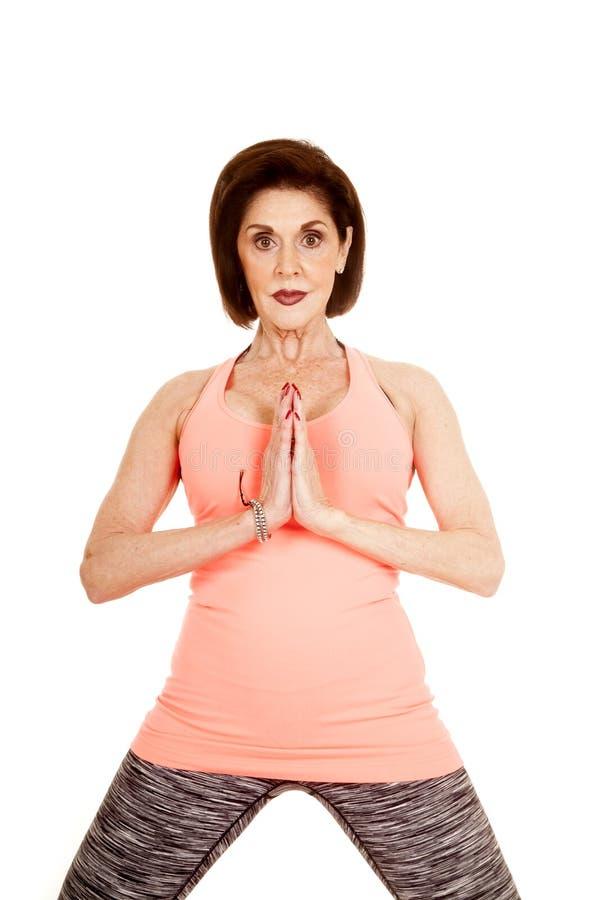 Yogabön för äldre kvinna royaltyfria bilder