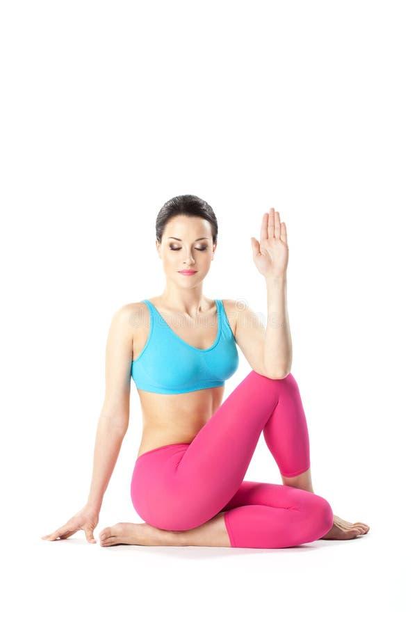 Yogakvinnan arkivfoton