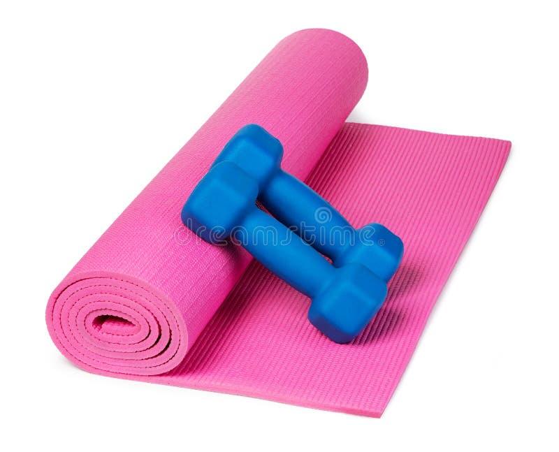 Yogamatte und -Dummk?pfe lizenzfreies stockbild