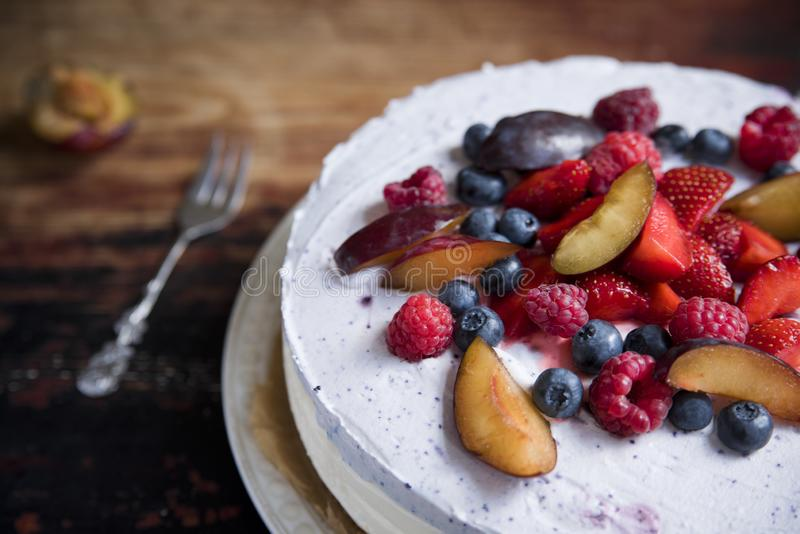 Yoghurt cake with rucola and berries on a vintage table stock images