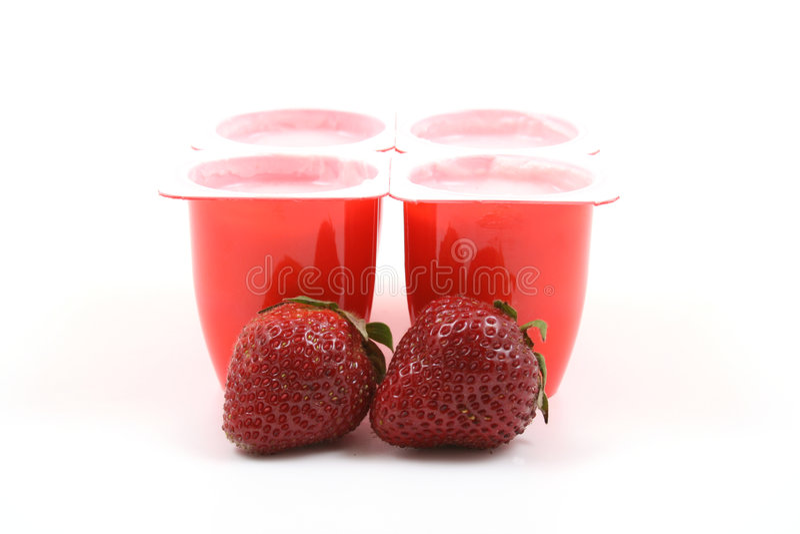 Yoghurt en aardbeien royalty-vrije stock foto's