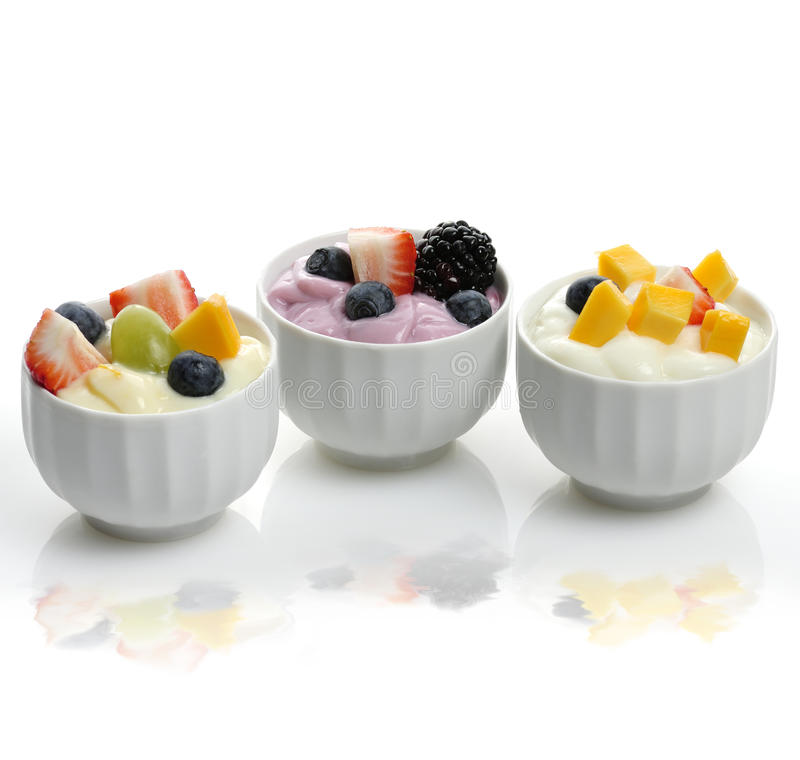 Yogurt Assortment With Fruits And Berries stock photos