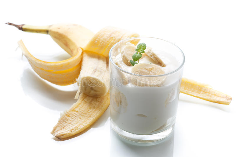 Yogurt with bananas. On a wtite background stock image