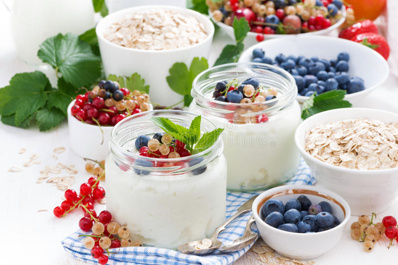 Yogurt with berries and products for healthy breakfast. Close-up royalty free stock image