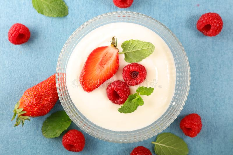 Yogurt and berry fruit. Top view royalty free stock images