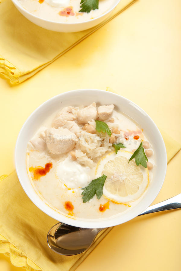 Yogurt chicken and rice soup. With large chunks of chicken and chick peas stock photos