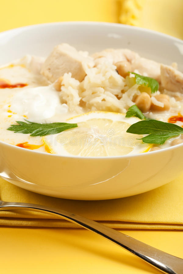Yogurt chicken and rice soup. With large chunks of chicken and chick peas royalty free stock photography