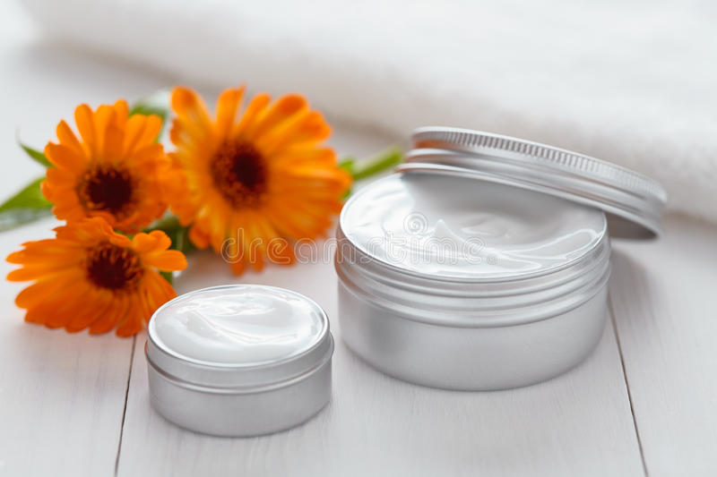 Yogurt cosmetic cream with calendula flowers vitamin spa lotion. Organic herbal skin cleansing moisturizer product. Medical dermatology anti aging, acne royalty free stock photography