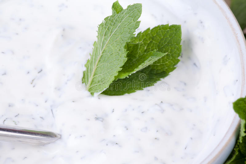 Yogurt dip with mint. S and cucumbers royalty free stock photography
