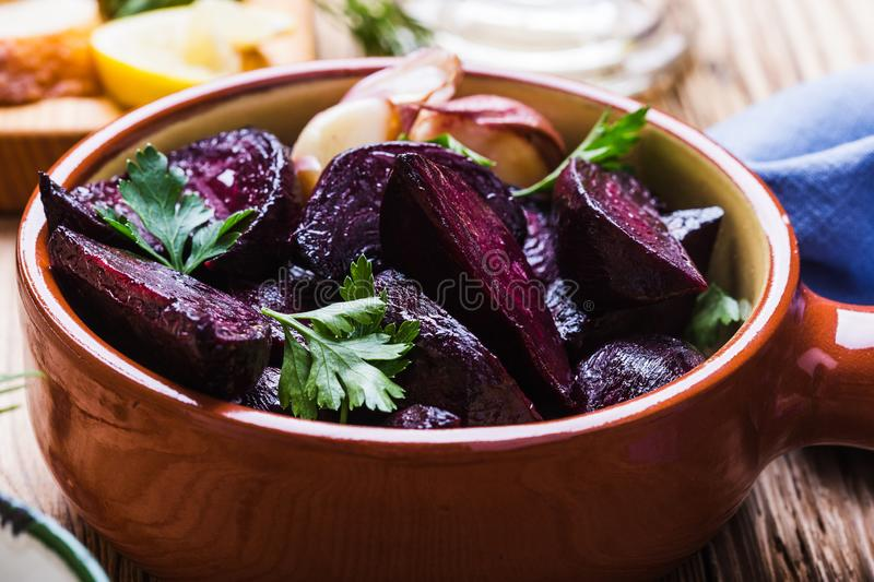 Yogurt dip with parsley, roasted beets, vegan plant based meal. Yogurt dip with parsley, dill and lemon juice served on rustic wooden table with roasted beets royalty free stock photography